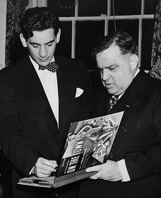 Bernstein autographing his new recording of On the Town for New York's Mayor Fiorello LaGuardia